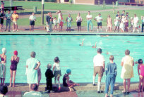 Merrylands Swimming Centre - 1970One of the historic photos donated by the Smart family as part of the club's 40th Anniversary celebrations. Club Members throw a swimmer into the pool at Merrylands Swimming Centre circa 1970.