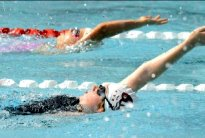 Hayley Baker & Claire CuskellyHayley Baker and Clair Cuskelly swim in the 50m Backstroke at the 2011 Merrylands SwimFest at Merrylands Swimming Centre on Saturday, 19th February, 2011. The meet was the best attended since 2008 with 255 swimmers representing 34 clubs.